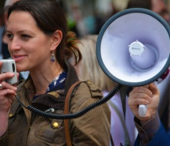 Woman speaking into megaphone