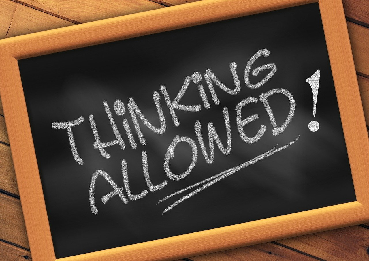 thinking allowed written on chalk board