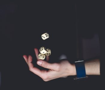 Photo of person ready to roll dice