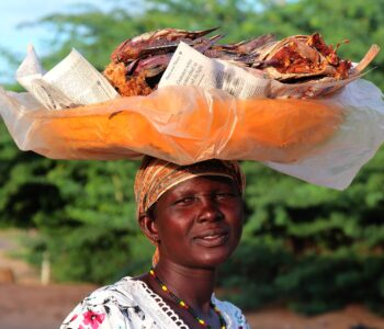 Photo of woman with basket on head