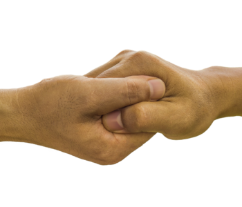 Photo of two people clasping hands