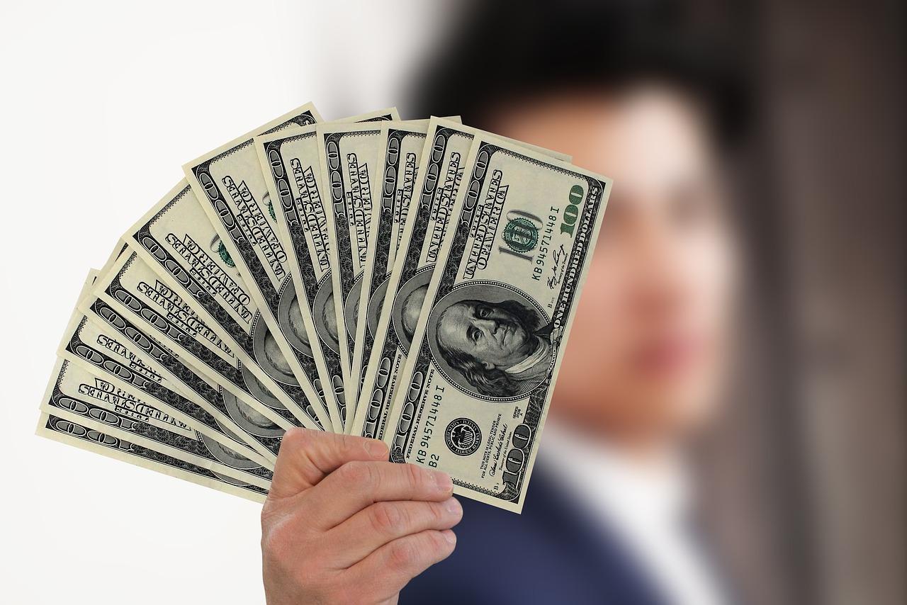 Man holding up dollar bills