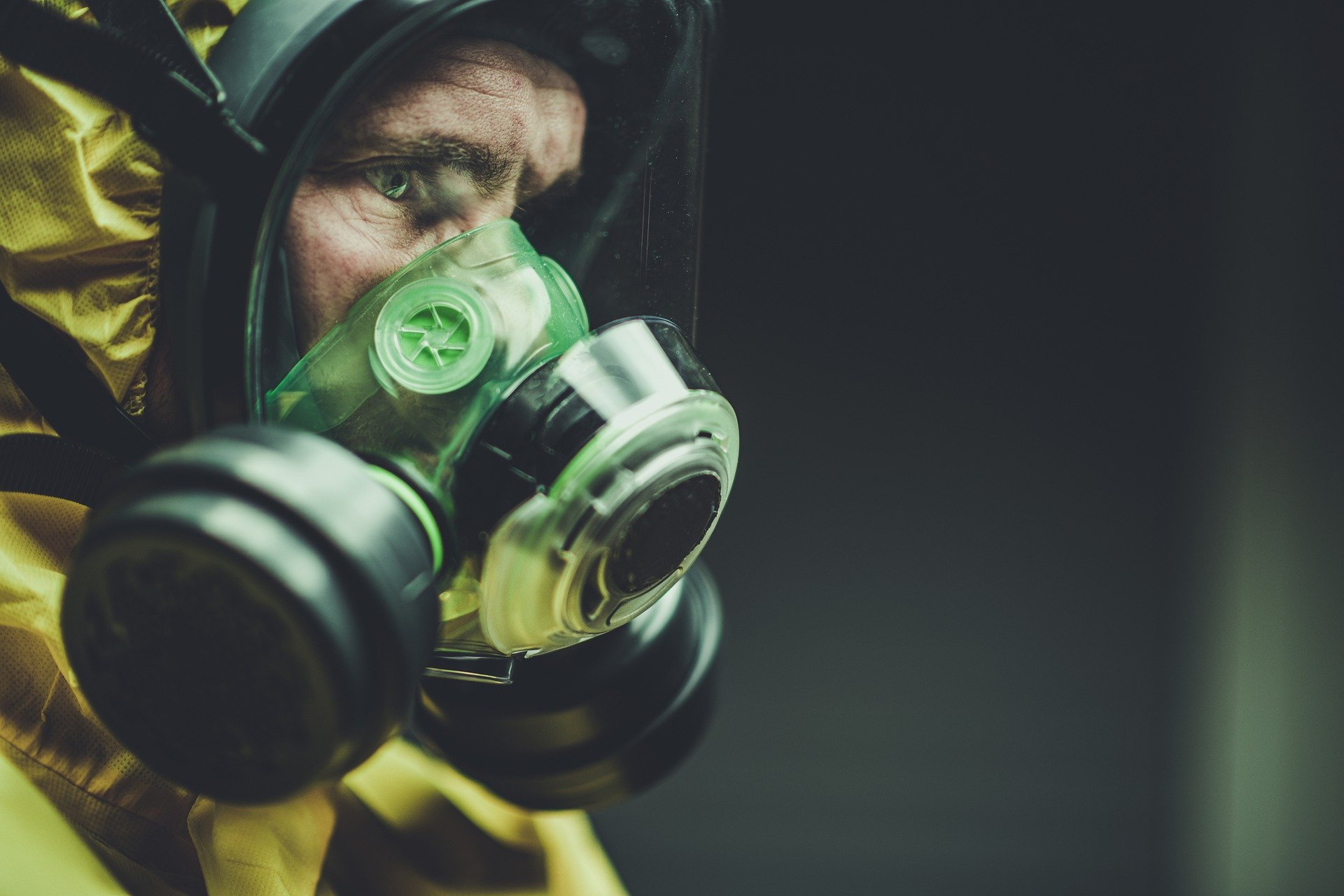 photo of man wearing respirator mask against covid 19